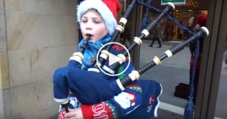 Young Scottish Bagpipers In Scotland